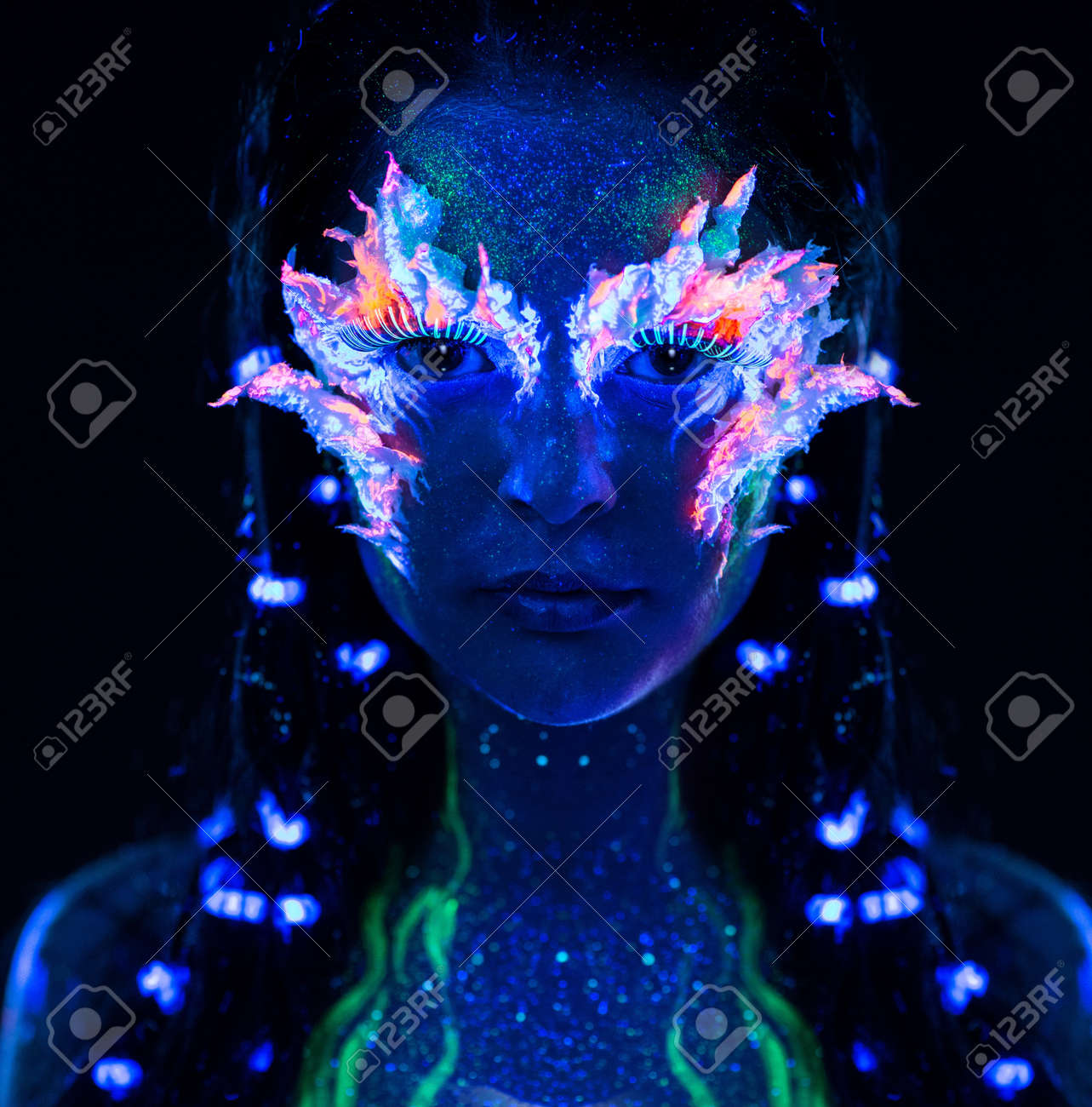 Portrait of beautiful woman with body art glowing in ultraviolet light Stock Photo - 18191887