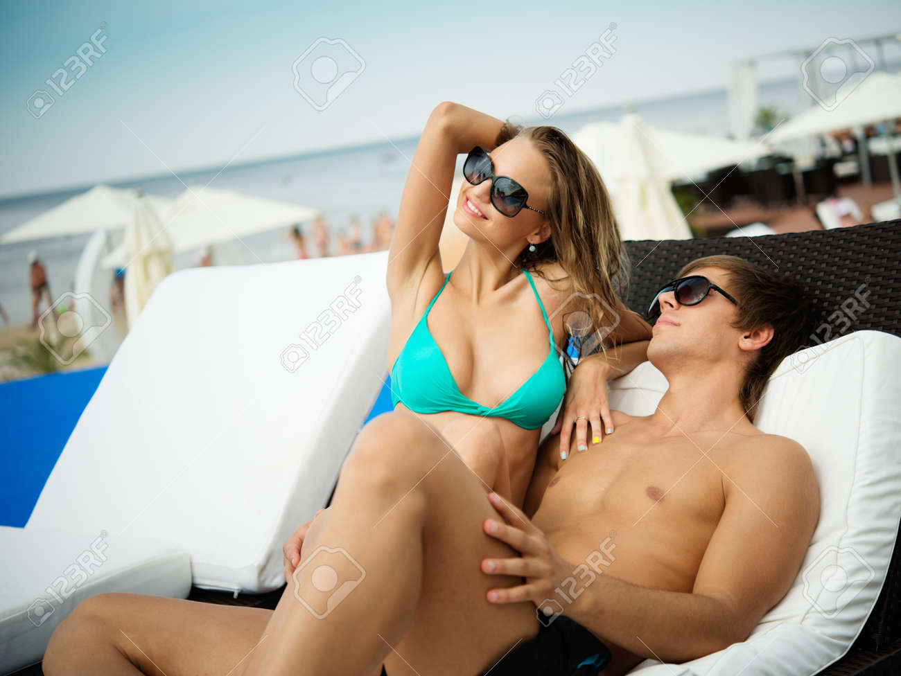 Sexy young couple relaxing on a beach bed Stock Photo - 21131173