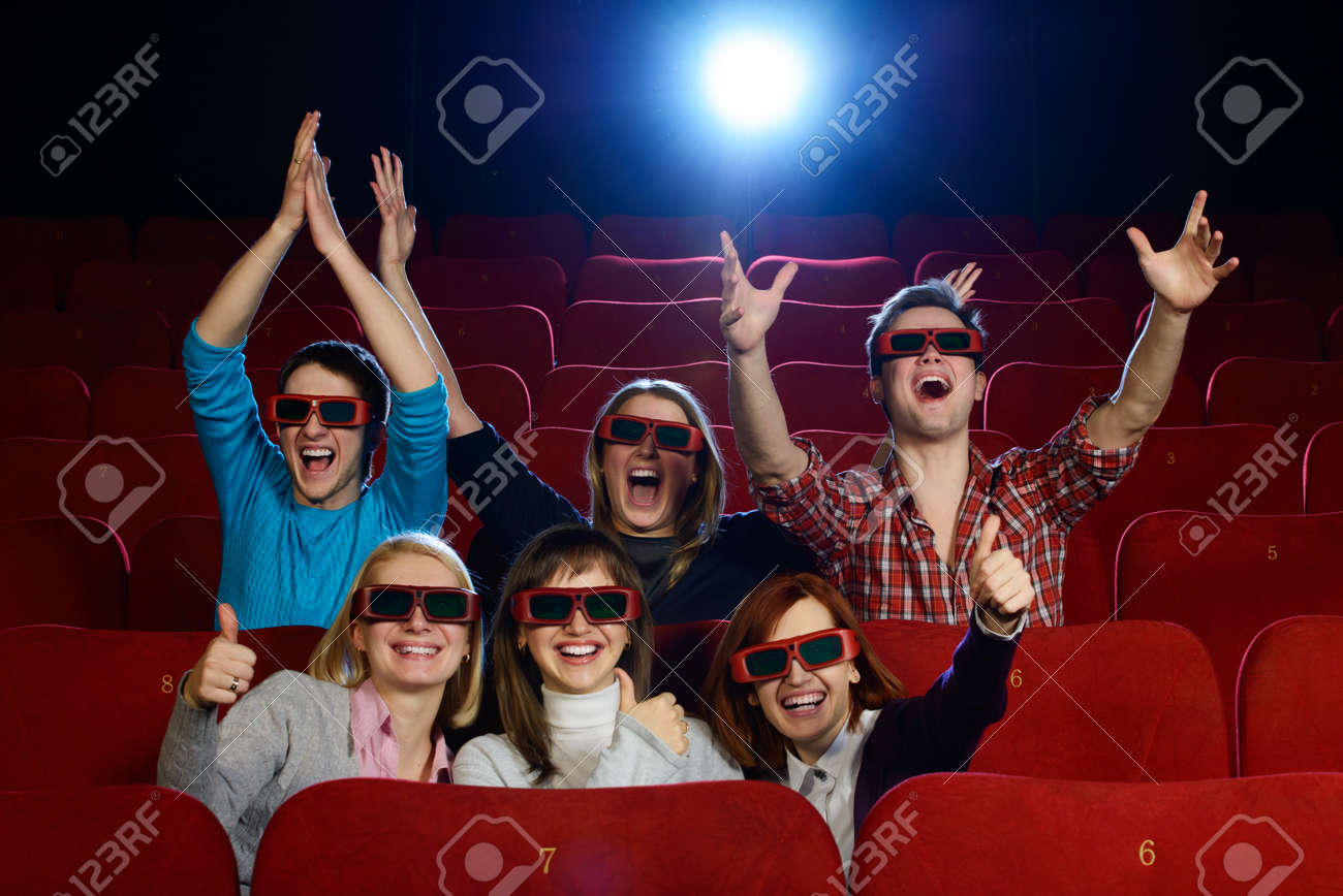 Group of people in 3D glasses watching movie in cinema Stock Photo - 22782502