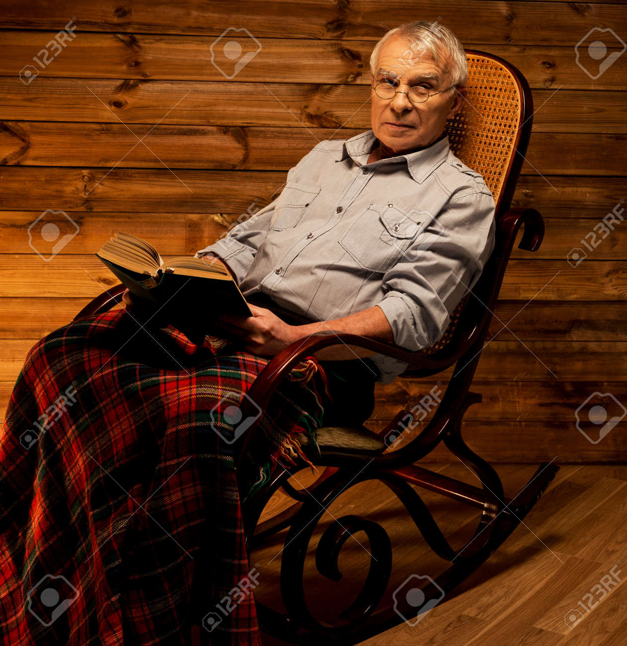 Admirable Senior Man Sitting In Rocking Chair In Homely Wooden Interior Squirreltailoven Fun Painted Chair Ideas Images Squirreltailovenorg