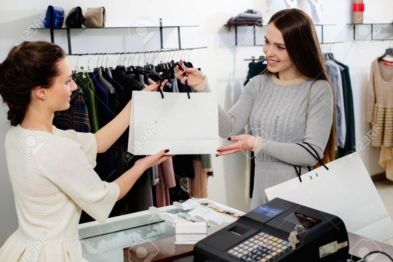 Happy Customer With Shopping Bag In Fashion Showroom Stock Photo ...