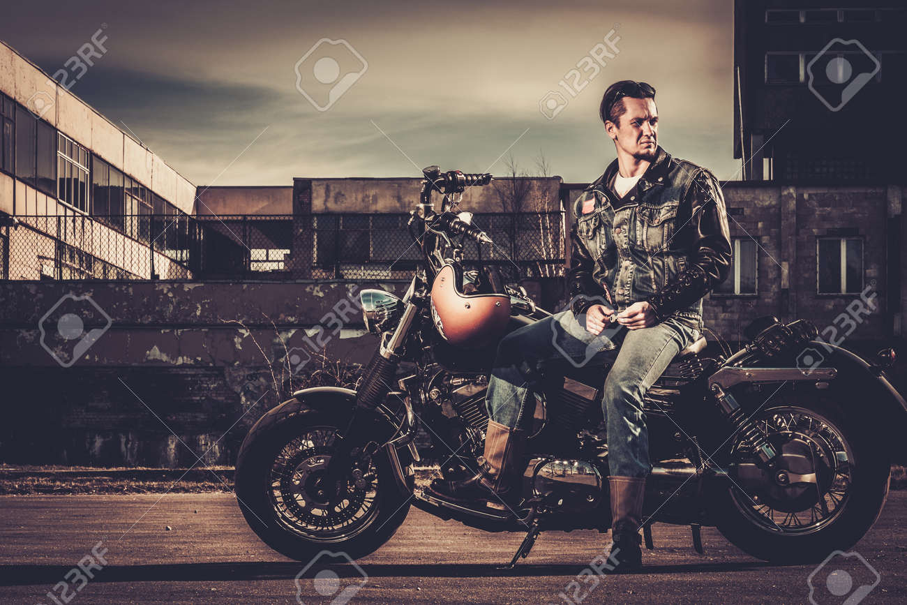 Biker And His Bobber Style Motorcycle On A City Streets Stock Photo Picture And Royalty Free Image Image 38936382