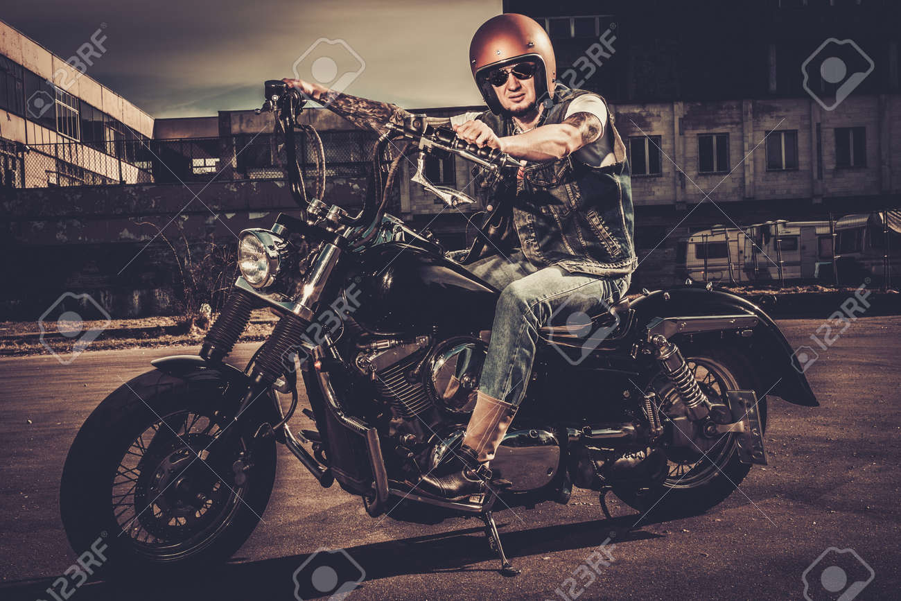 Tattooed Biker And His Bobber Style Motorcycle On A City Streets Stock Photo Picture And Royalty Free Image Image 38936384