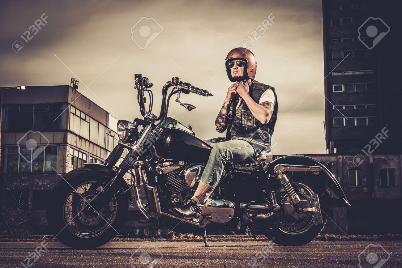 Tattooed Biker And His Bobber Style Motorcycle On A City Streets Stock Photo Picture And Royalty Free Image Image 38936385