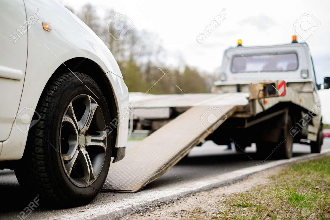 Loading Broken Car On A Tow Truck Roadside