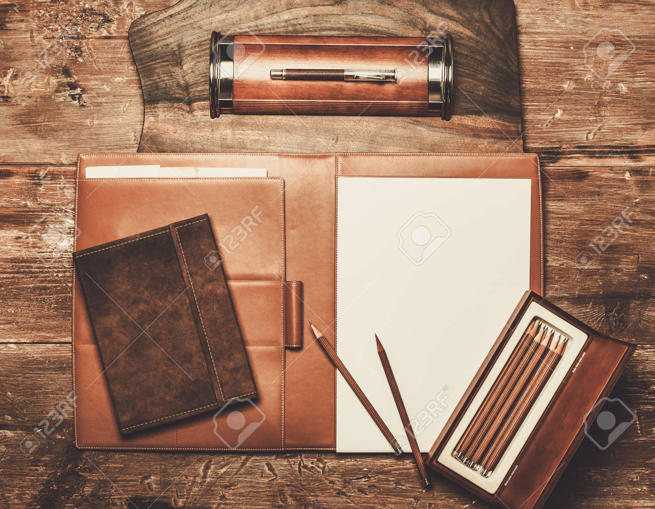 Luxurious writing tools on a wooden table - 41809070