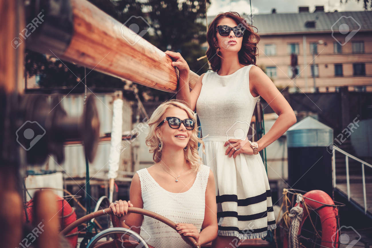 Stylish wealthy women on a luxury yacht Stock Photo - 42859678