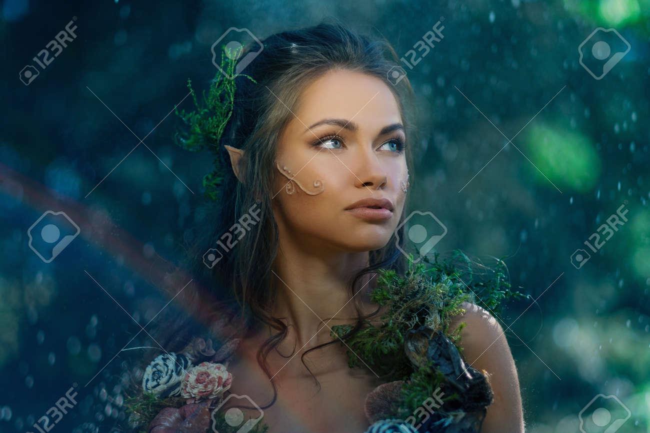 Elf woman in a magical forest Standard-Bild - 43589444