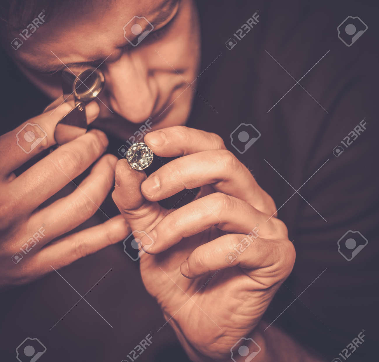 Portrait of a jeweler during the evaluation of jewels. Stock Photo - 50661965