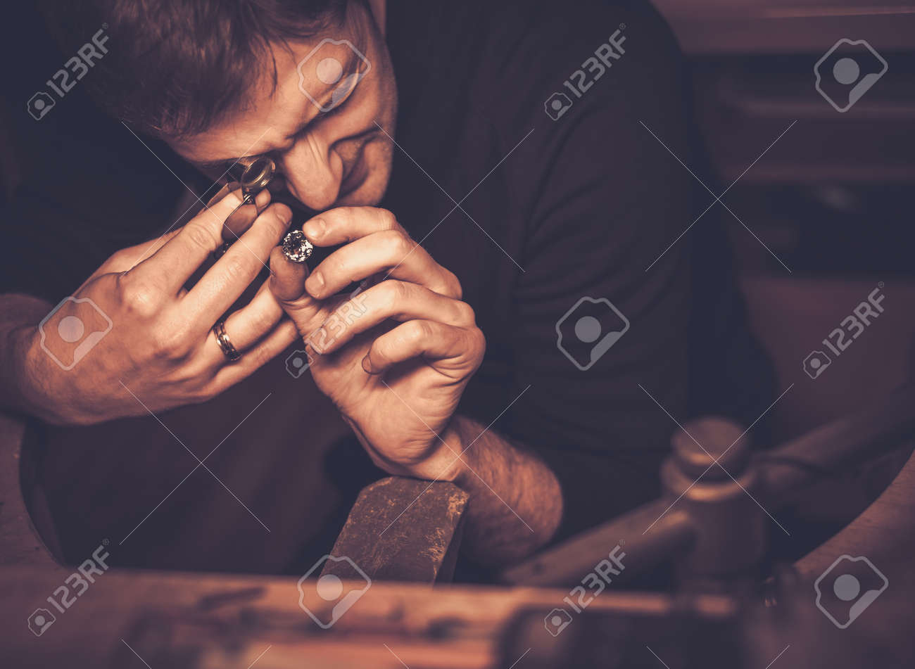 Portrait of a jeweler during the evaluation of jewels. Stock Photo - 50662032