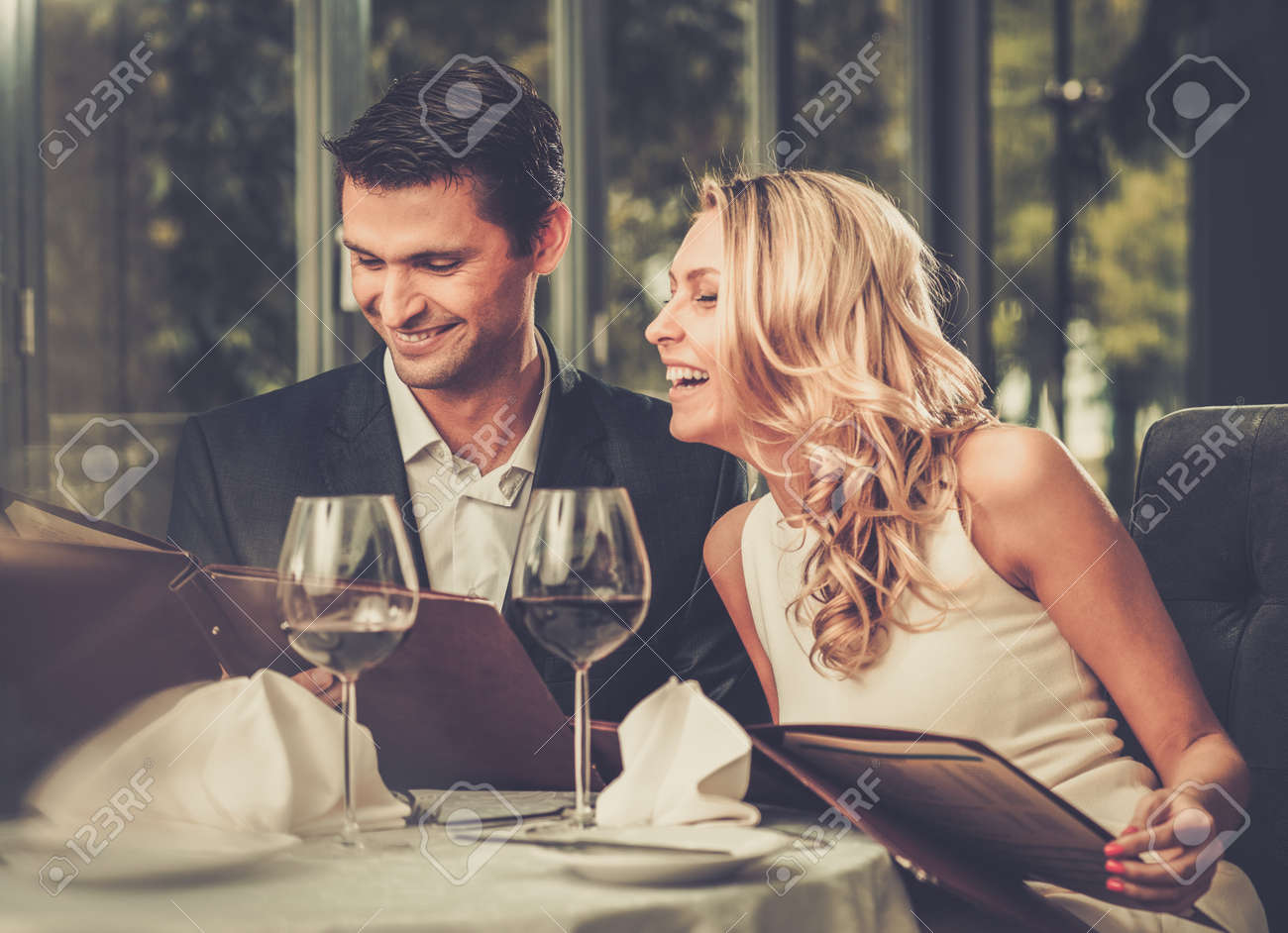 Cheerful couple with menu in a restaurant Stock Photo - 50662040
