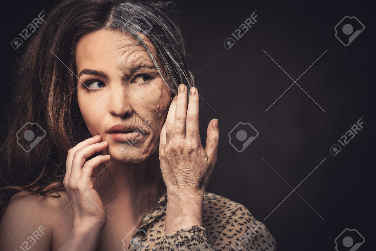 Aging and skin care concept. Half old half young woman. Stock Photo - 52547775