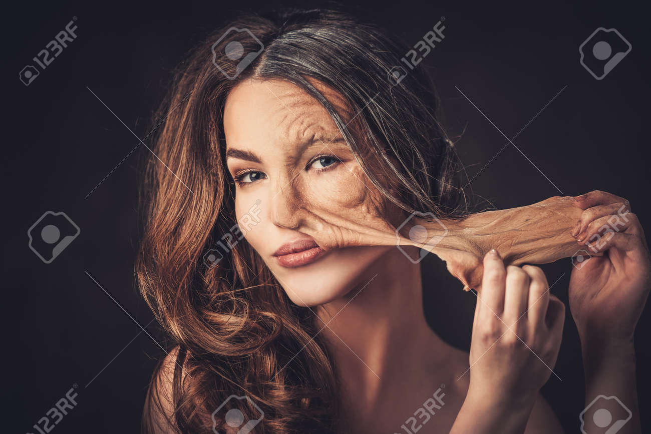 Aging and skin care concept. Half old half young woman, takes off the old skin from the face. Stock Photo - 52621250