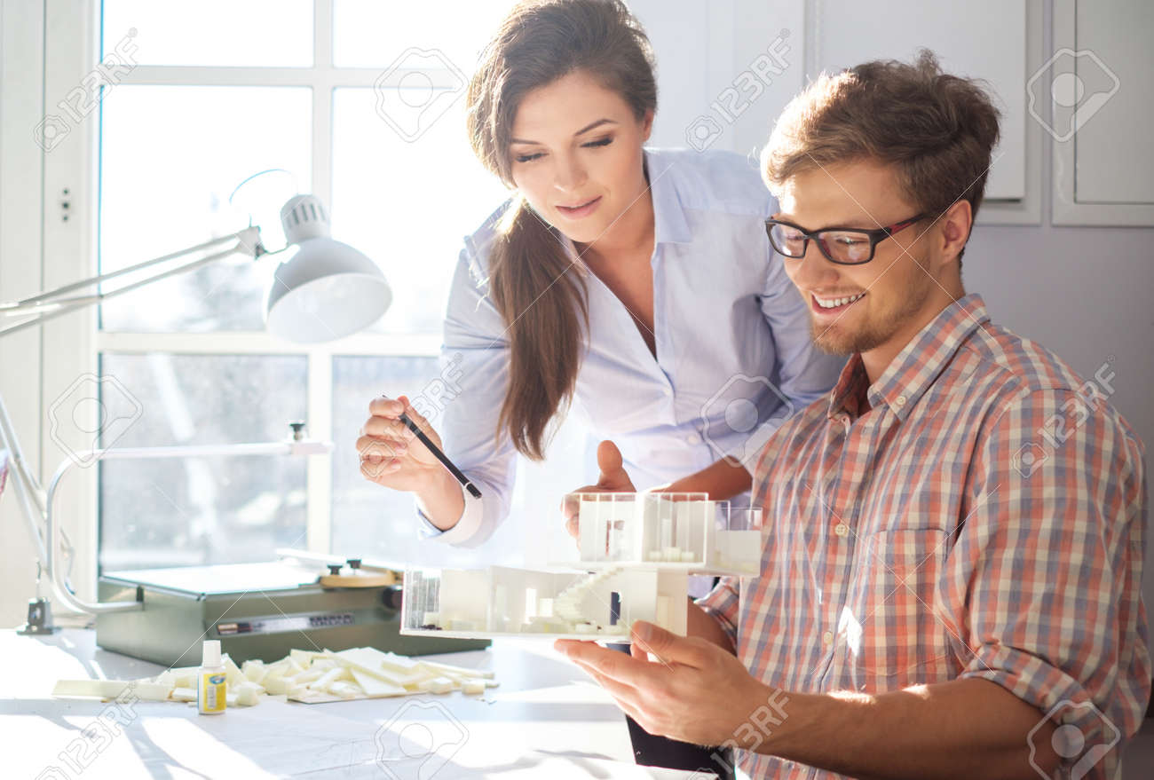 Confident team of engineers working together in a architect studio. - 54363051