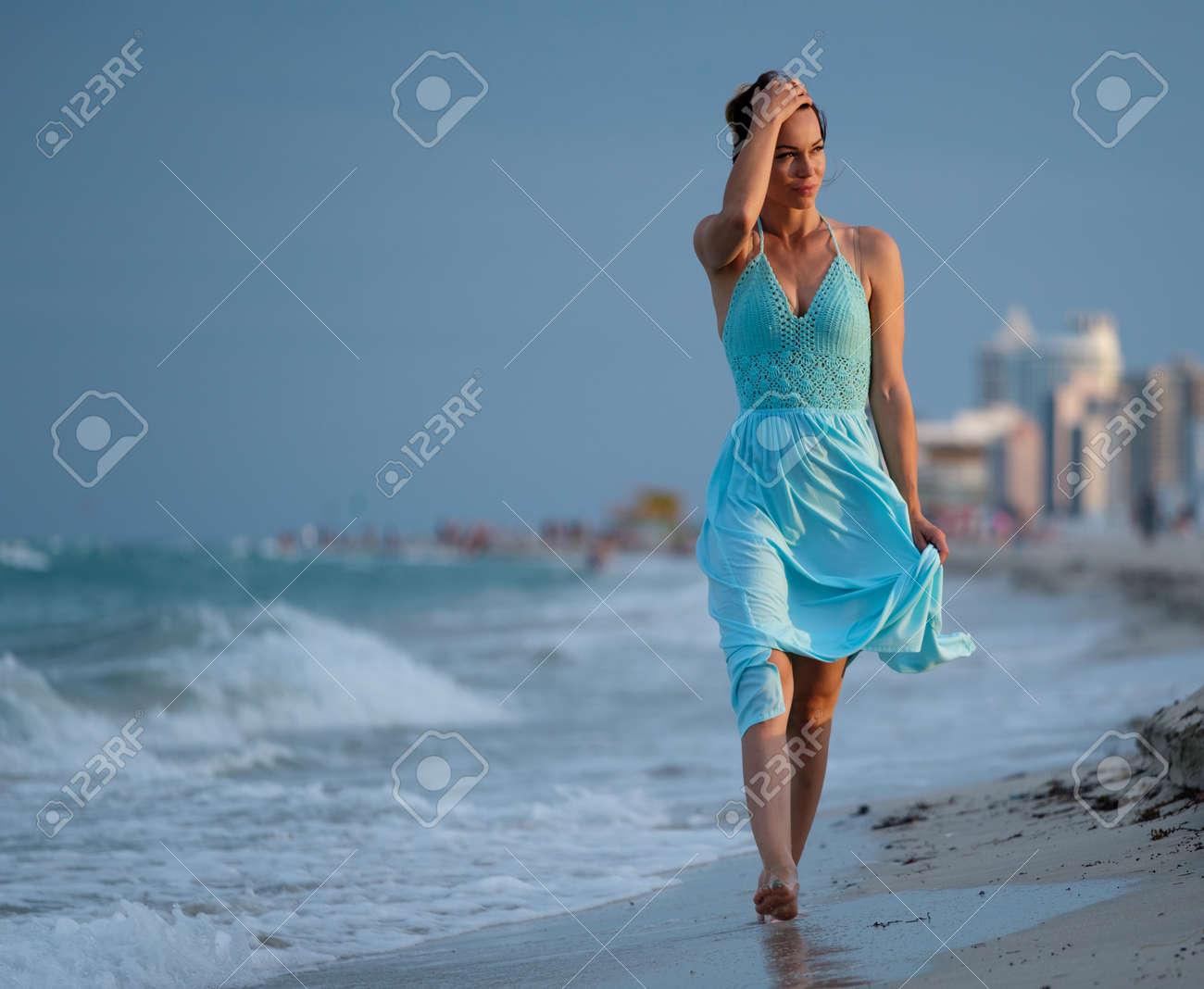 Beautiful woman walking along the South beach, Miami, USA - 64592556
