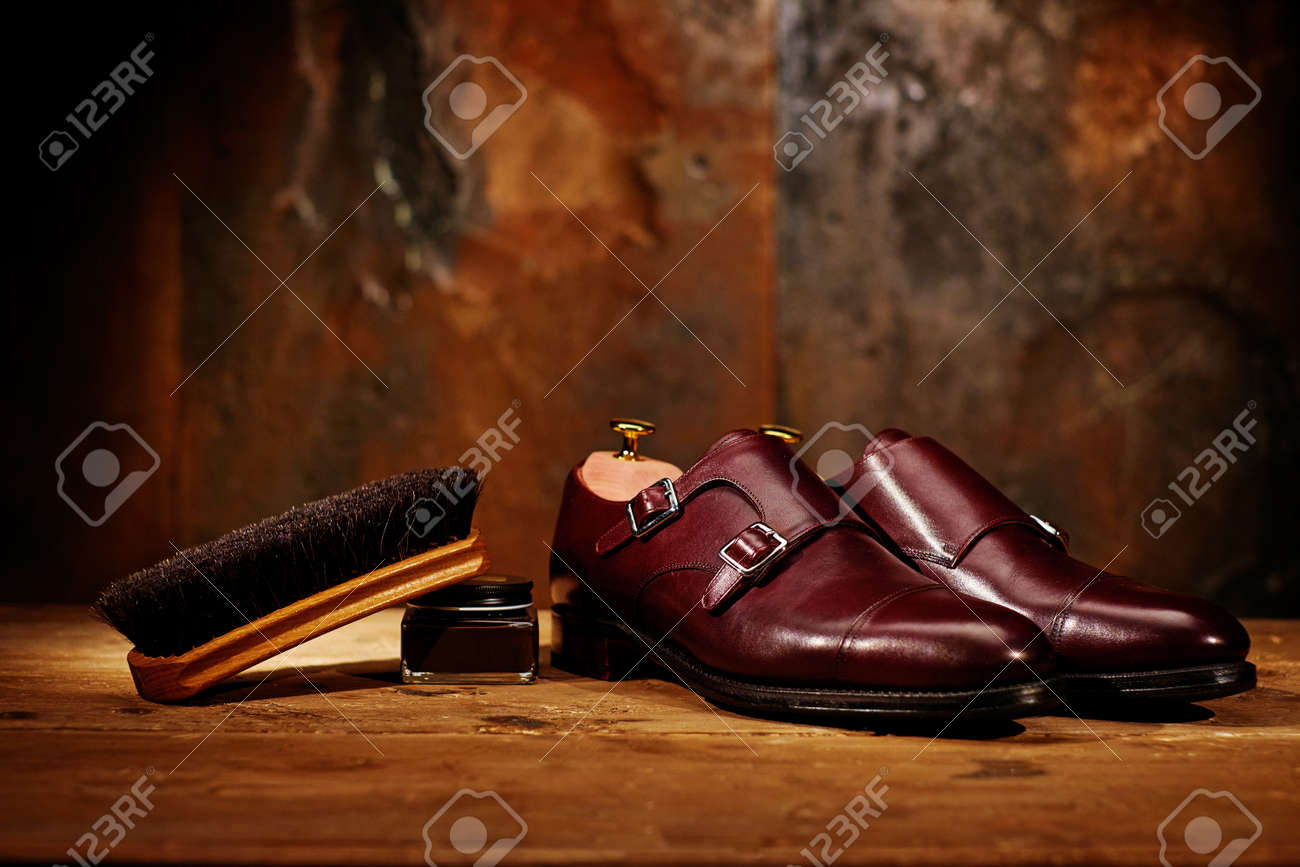 Still life with men's leather shoes and accessories for shoes care - 102895501