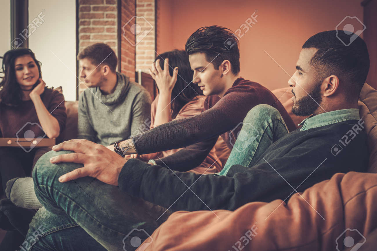 Group of multi ethnic young friends having fun in home interior Stock Photo - 68465356