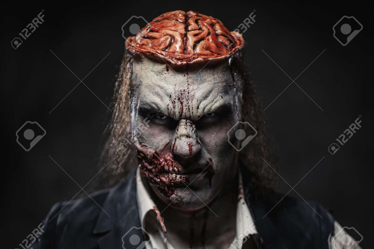 Scary zombie prostheric makeup on male model - 110565542