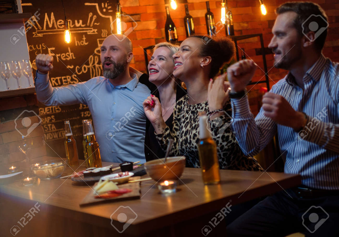 Group Of Friends Watching Tv In A Cafe Behind Bar Counter Stock Photo Picture And Royalty Free Image Image 119161803