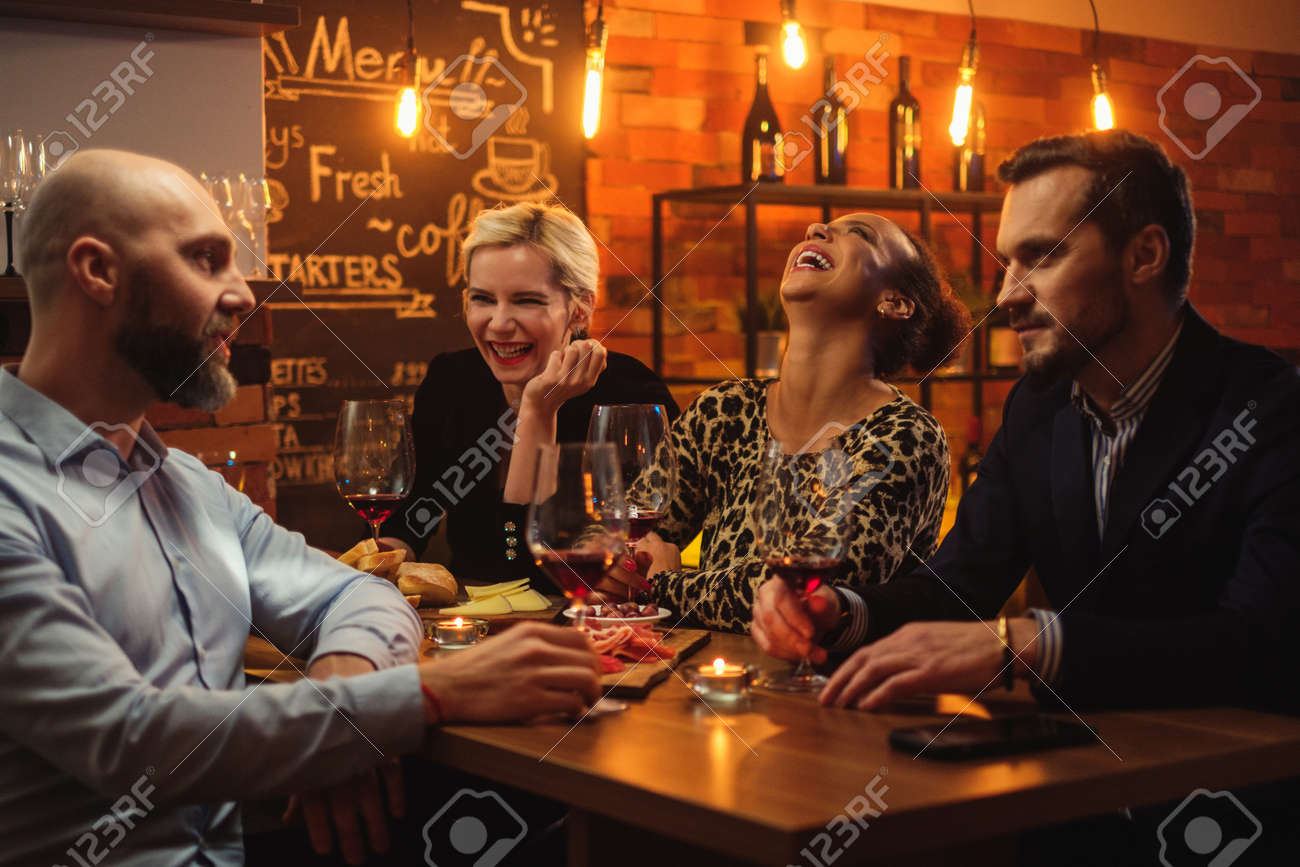 Group of friends having fun talk behind bar counter in a cafe - 119426836