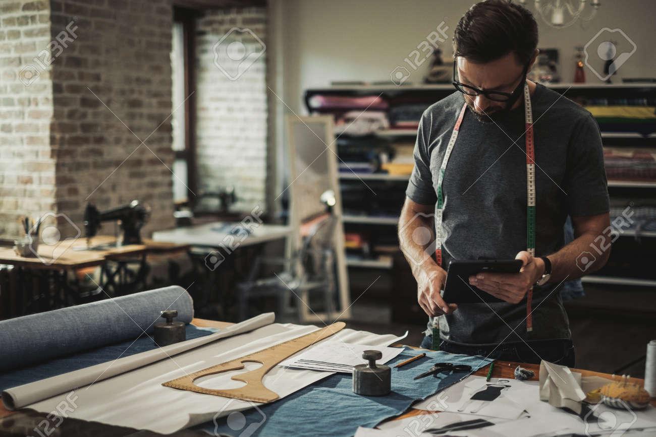 Fashion designer working in his studio - 124309526