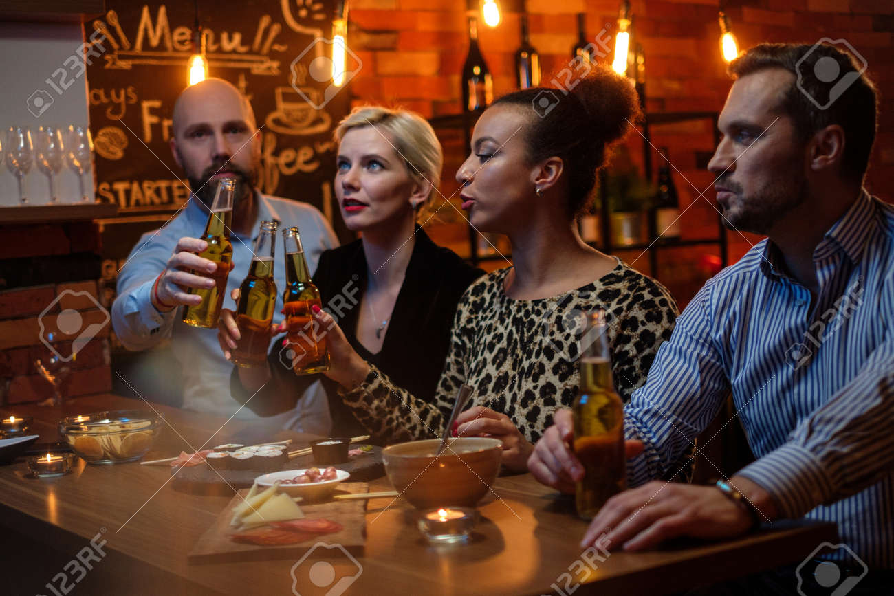 Group Of Friends Watching Tv In A Cafe Behind Bar Counter Stock Photo Picture And Royalty Free Image Image 132532737