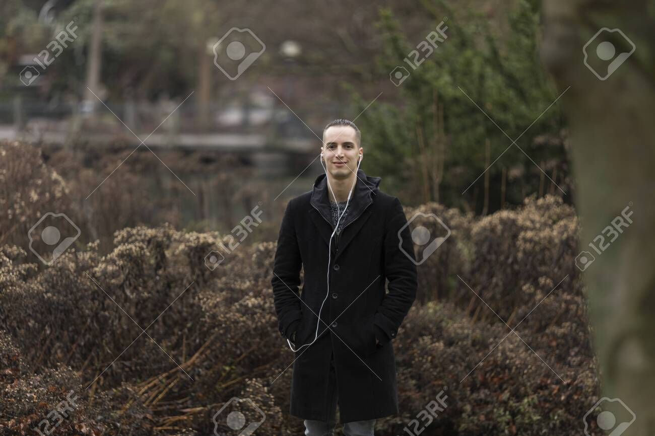 Portrait of Young Man Standing in Park - 143965837