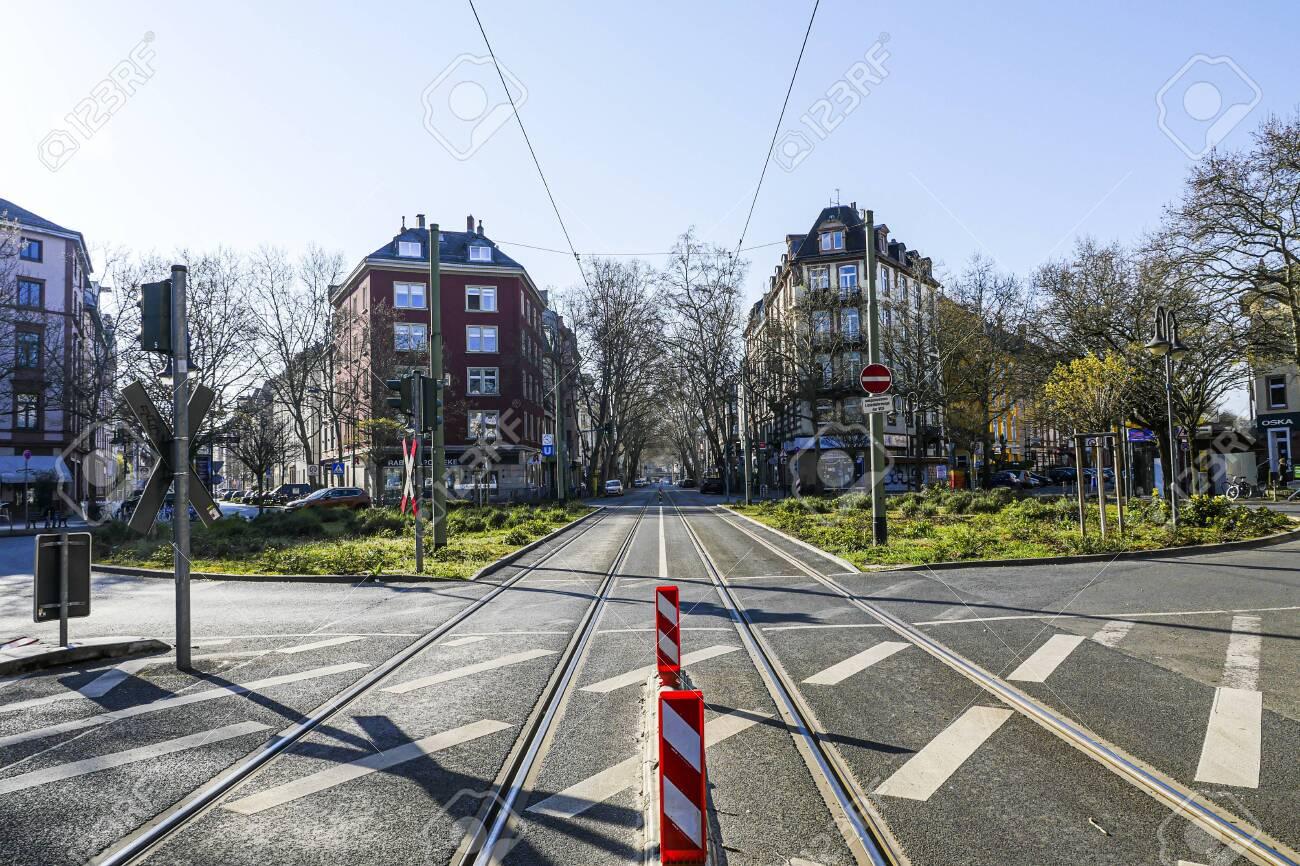 Coronavirus lockdown. Frankfurt, Germany. April 5, 2020. Schweizer Platz crosswalk with empty streets during quarantine. - 144821541