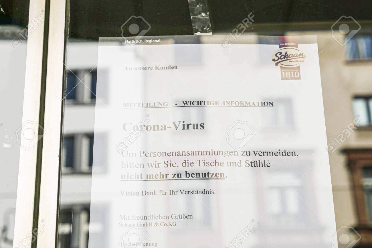Coronavirus lockdown. Frankfurt, Germany. April 5, 2020. Coronavirus warning sign printout in German on glass. - 144821544