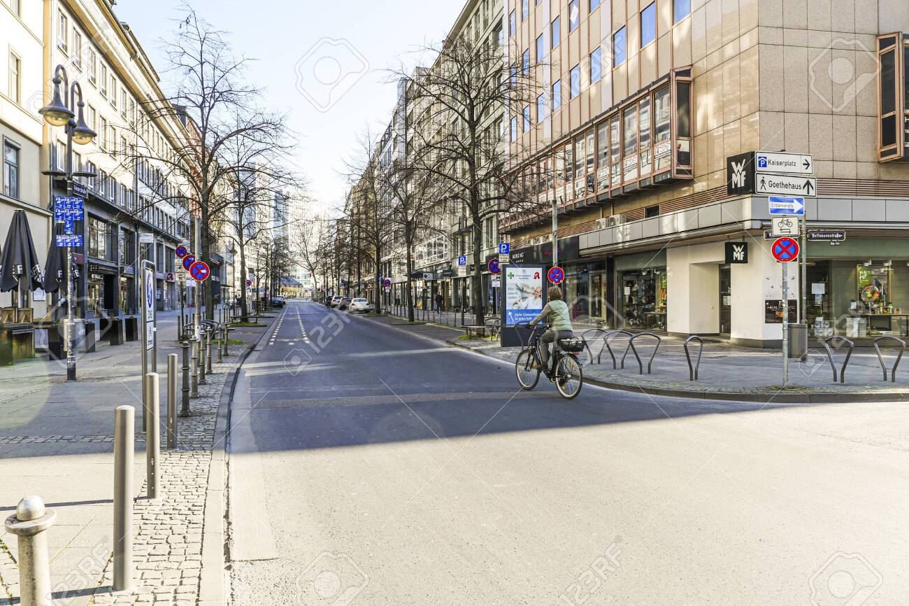 Coronavirus lockdown. Frankfurt, Germany. April 5, 2020. Street in downtown Frankfurt with no traffic and one bicycle rider during quarantine. - 144821559