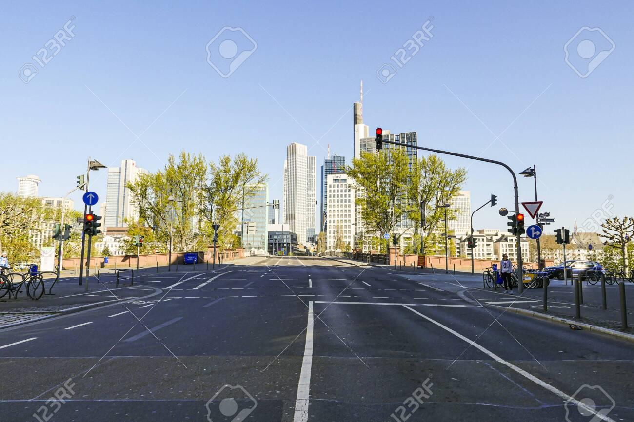 Coronavirus lockdown. Frankfurt, Germany. April 5, 2020. Empty road with Frankfurt's Financial District Bankenviertel in distance. - 144821562