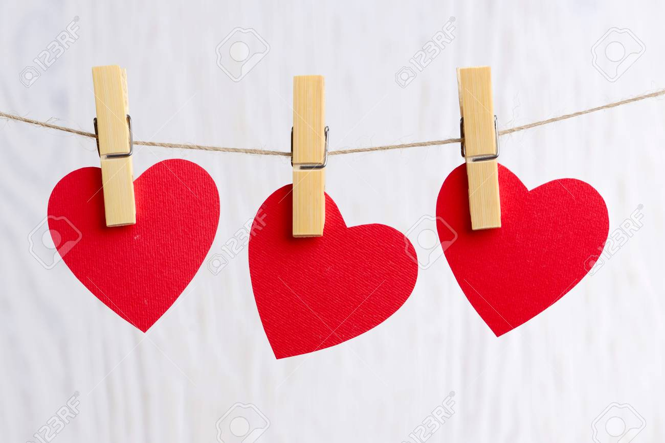 Three Love Hearts Hanging On Wooden Texture Background Valentines