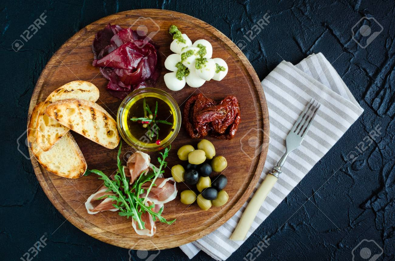 Meat and cheese plate antipasti snack with Prosciutto ham bresaola Mozzarella balls with pesto & Meat And Cheese Plate Antipasti Snack With Prosciutto Ham Bresaola ...