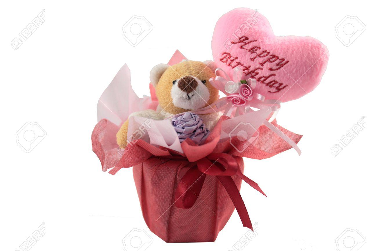 happy birthday teddy bear with a pink hearth balloon isolated