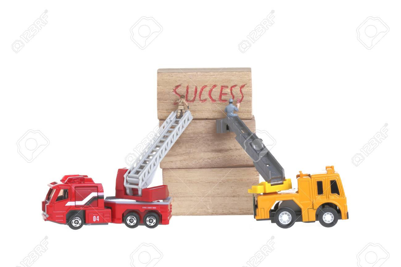 Success  concept dolls figure isolated on white Stock Photo - 28076400