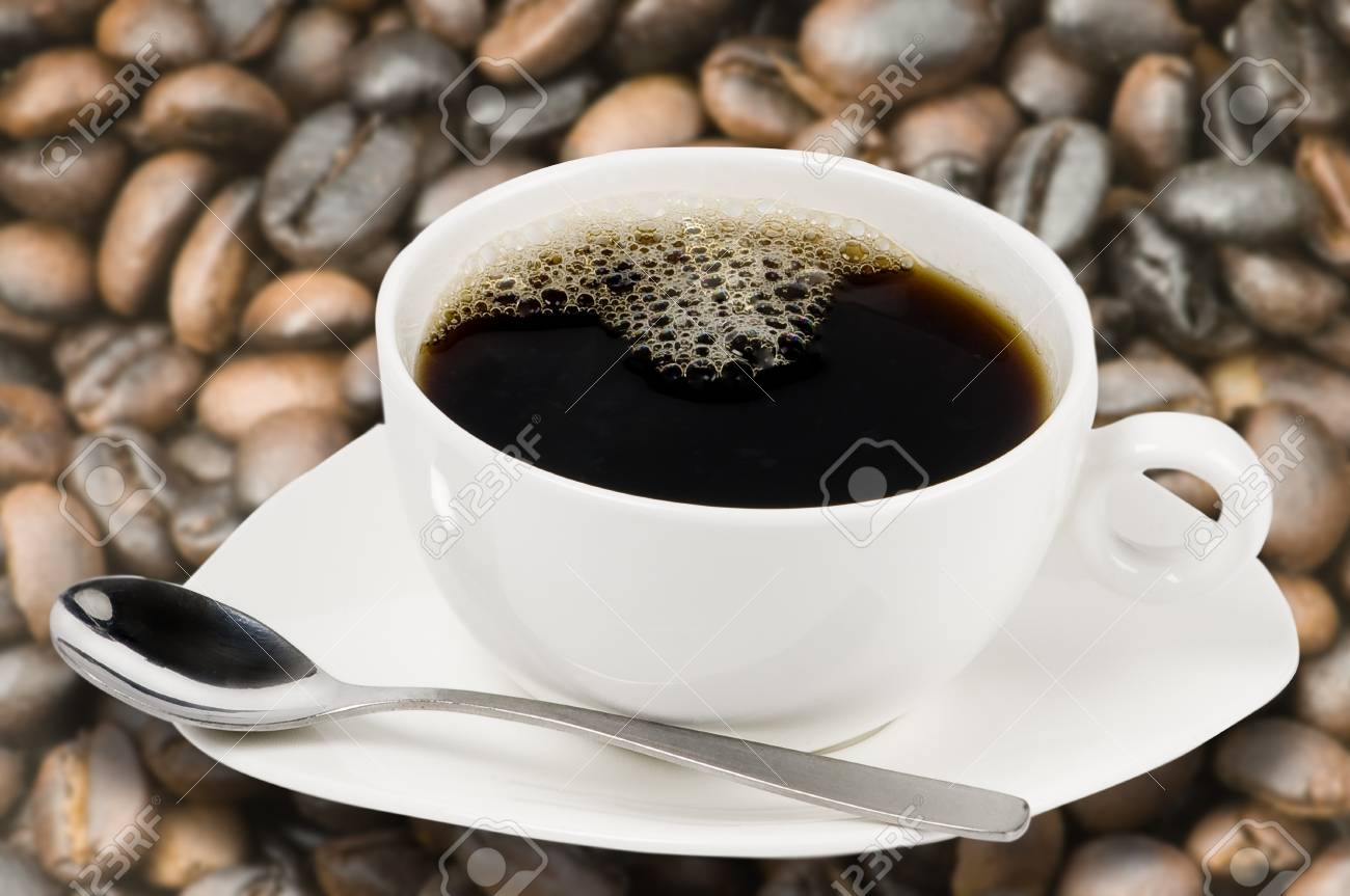 white coffee cup with coffee beans background Stock Photo - 10763638