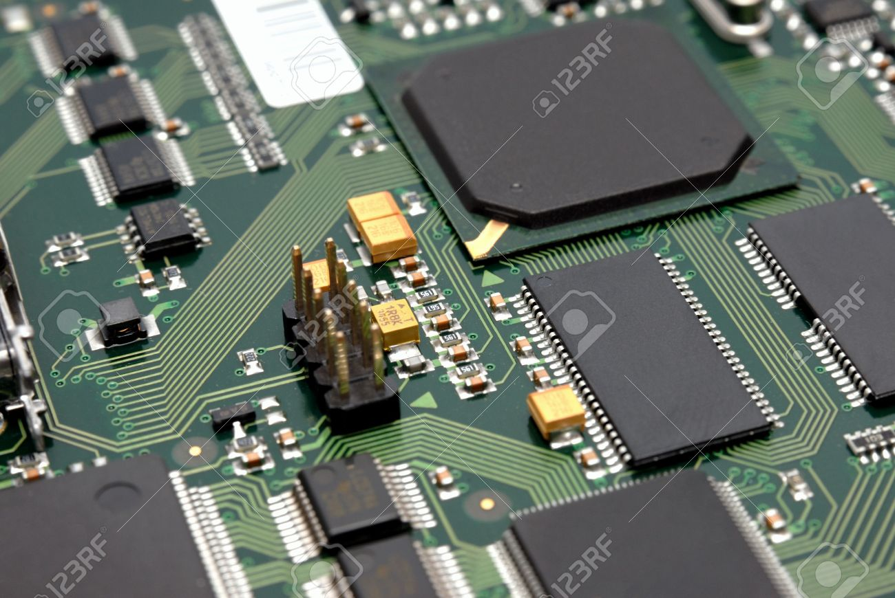 The Printed Circuit Board With Computer Chips Resistors And Stock Photo Condensers