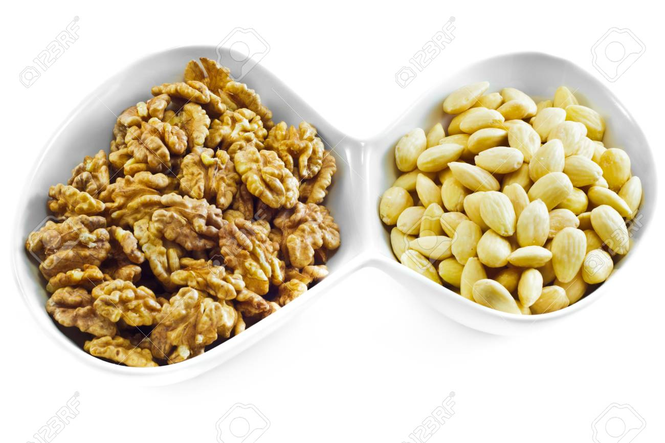 Almonds and Walnuts isolated on white background. Stock Photo - 11641938