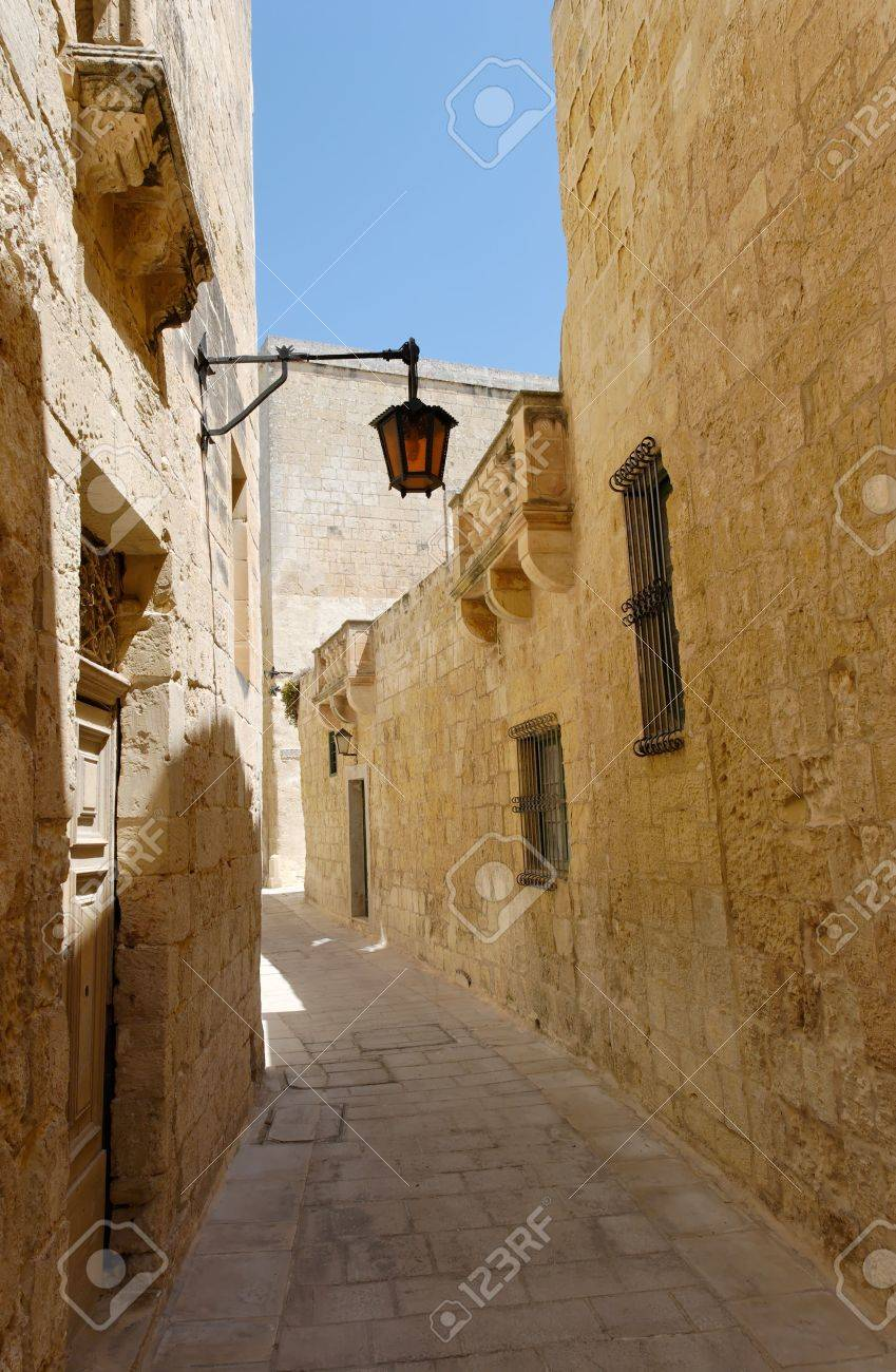 The empty silent narrow street of the Silent City - Mdina on Malta. Stock Photo - 3270846
