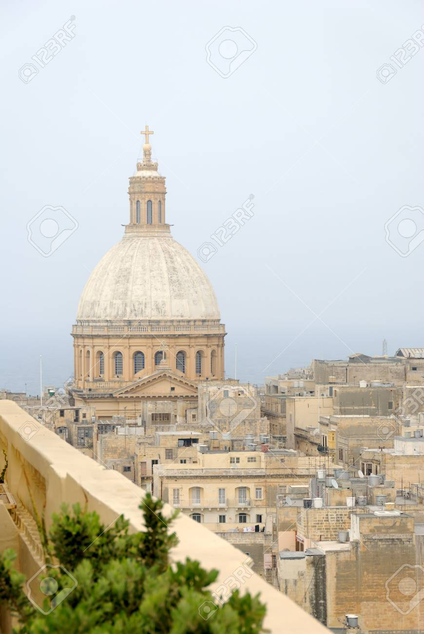 The dome of Our Lady of Mount Carmel church in Valletta, Malta. Photographed from a rooftop. Stock Photo - 3270736