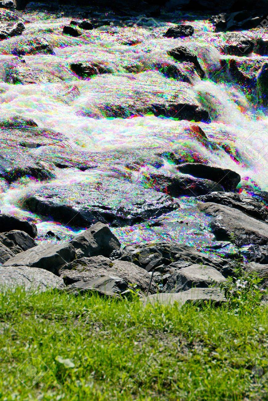 River glitters in red, green and blue sparks. The photo is combined from three exposures giving a