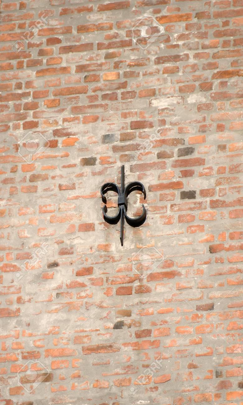 Cast iron fixture on sunlit brick wall. Stock Photo - 3736864