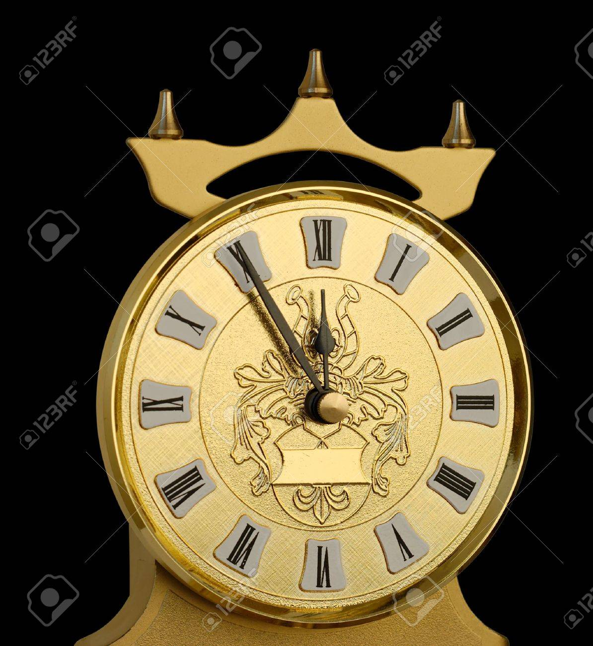 Clock dial showing five minutes to twelve. Stock Photo - 3834648
