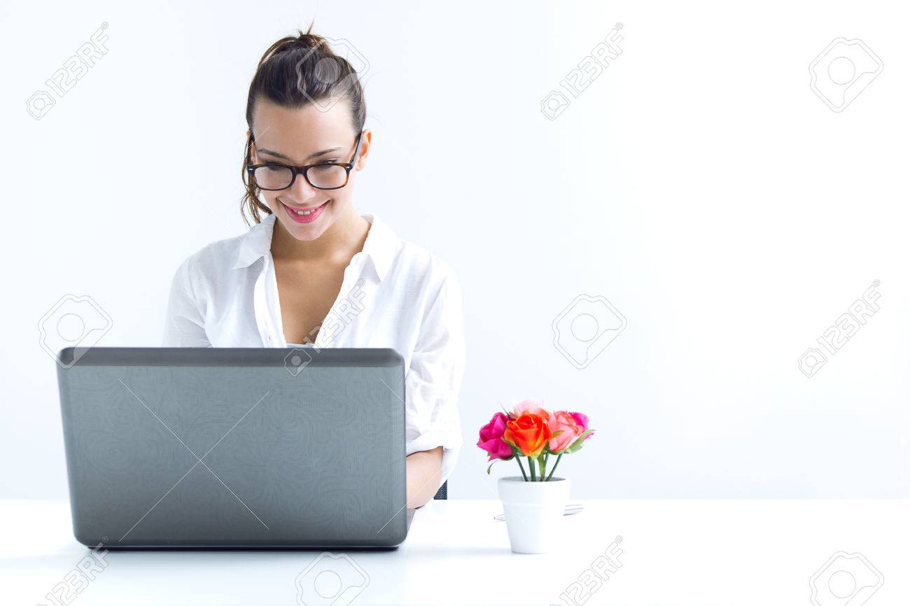 Beautiful young woman with laptop working at home - 41801269