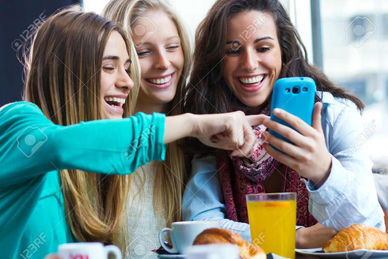 A group of friends having fun with smartphones - 43763329