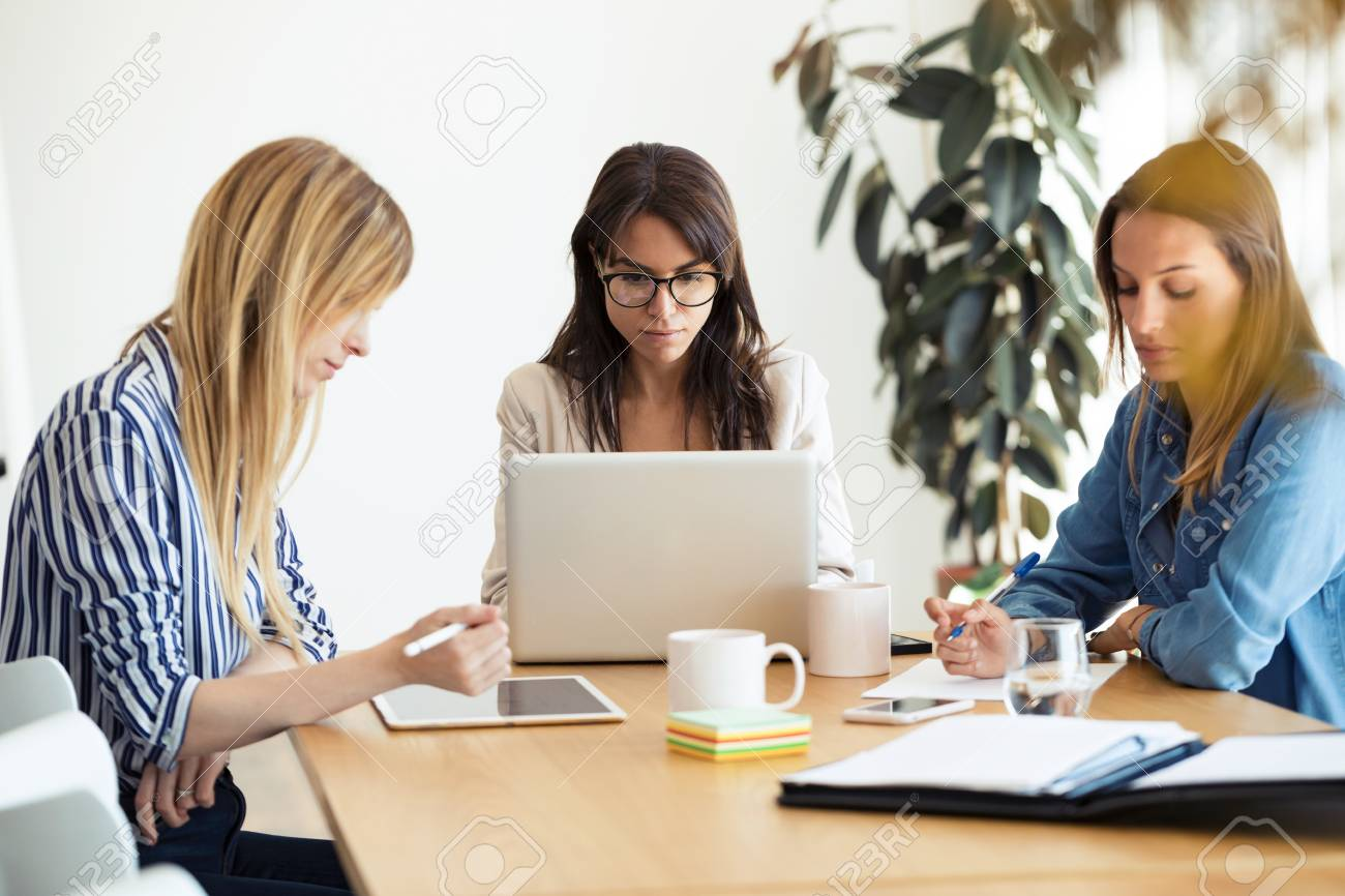 Shot of pretty young businesswomen working of new ideas in co-working space. - 121882185