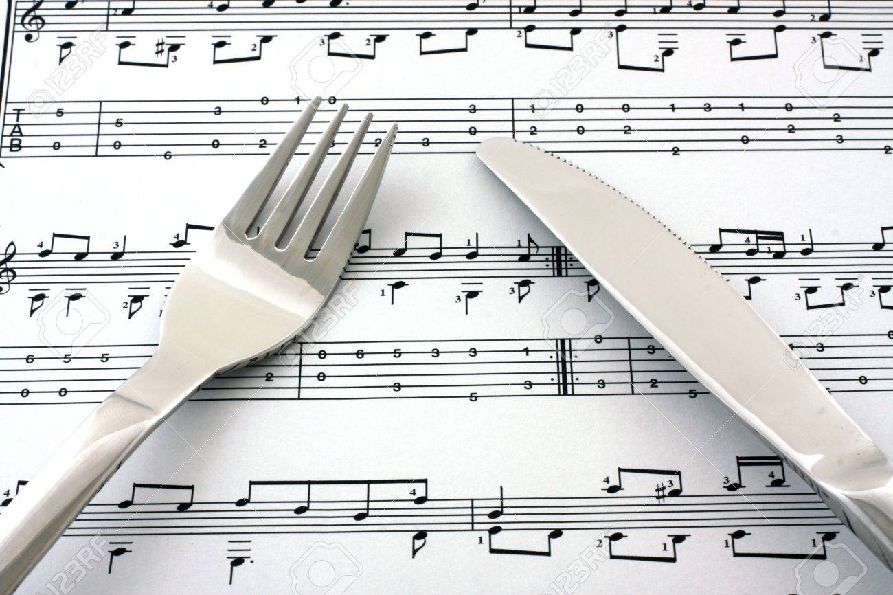 Sheet of notes with fork and knife Stock Photo - 7844081