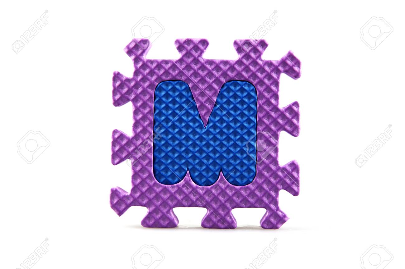 Alphabet puzzle pieces on white background Stock Photo - 8516573