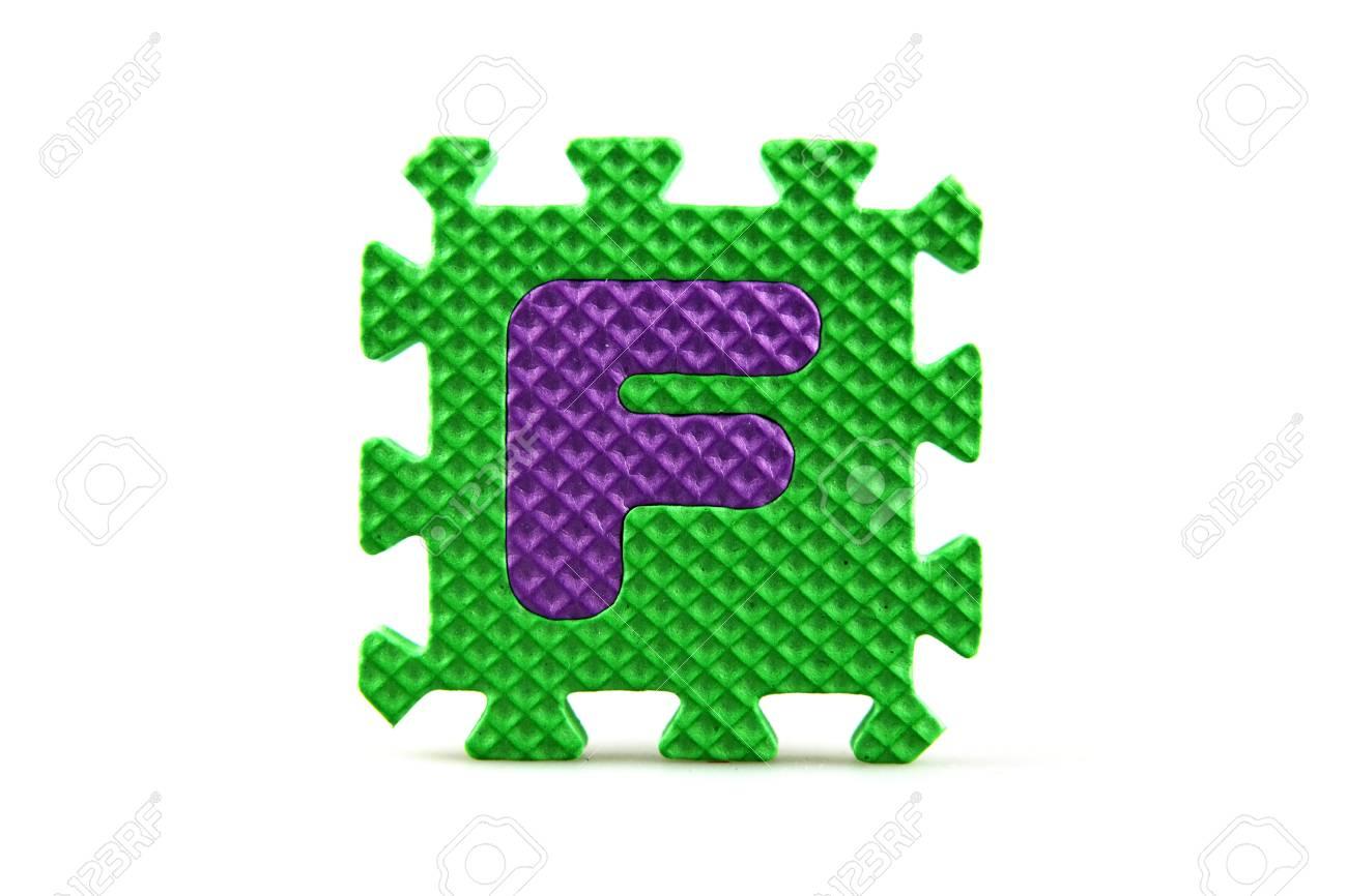 Alphabet puzzle pieces on white background Stock Photo - 8516575