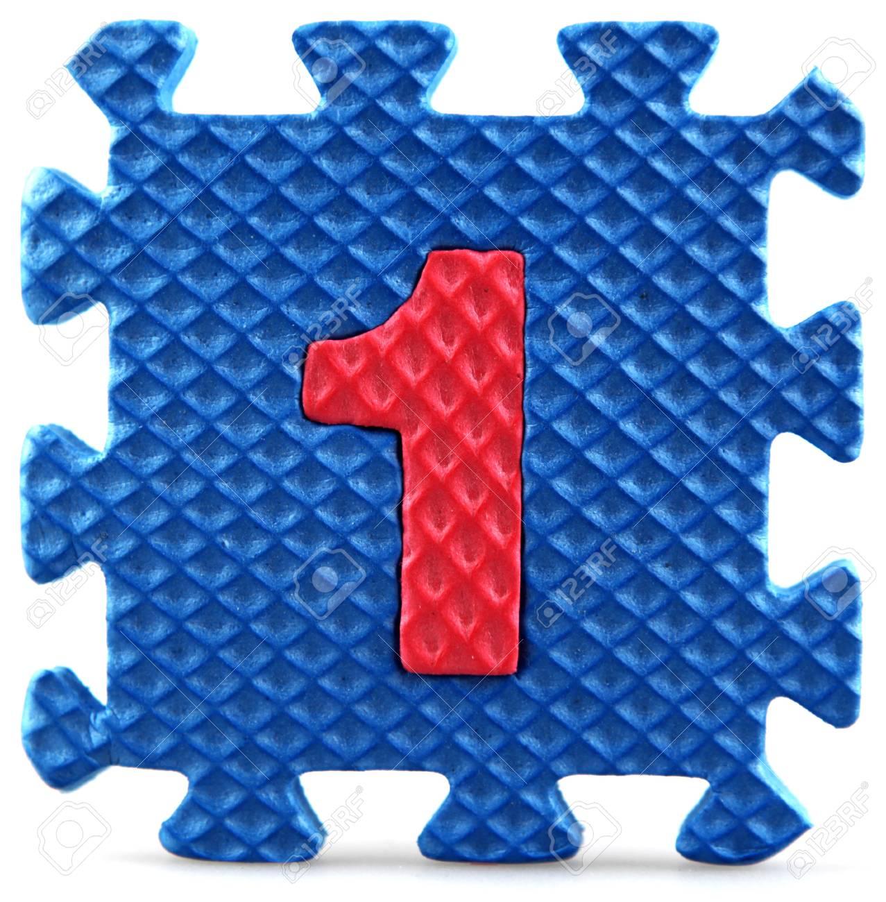 Alphabet puzzle pieces on white background Stock Photo - 9758919